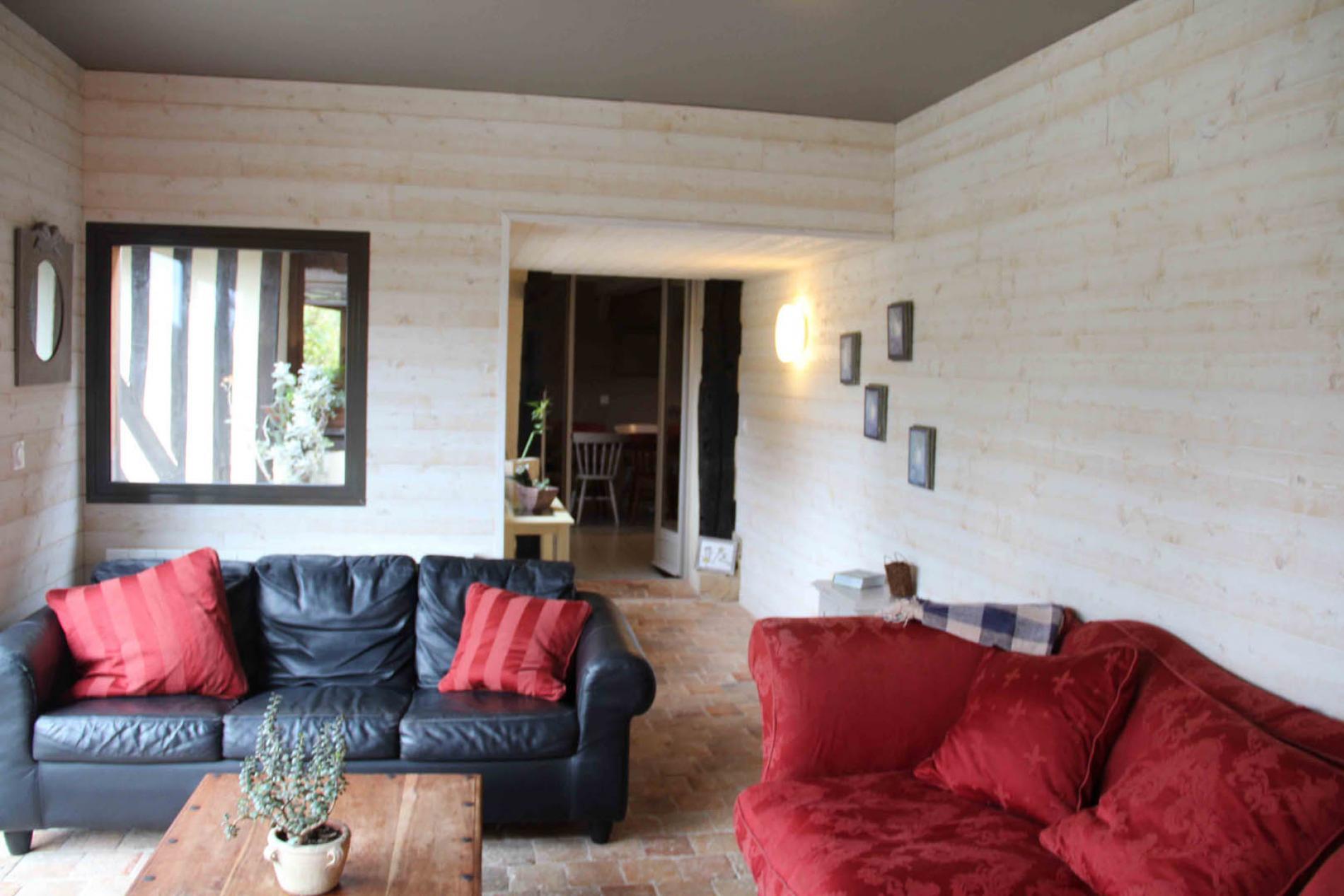 salon confortable avec un accès sur le séjour